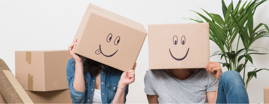 photo of a lovely couple with boxes that have smiling faces drawn on them