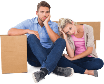 image of a tired couple after packing boxes